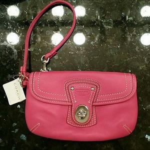 Coach legacy pink leather wristlet